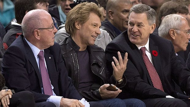 Bon Jovi, centre, took in a Toronto Raptors game last season with Maple Leaf Sports and Entertainment CEO Tim Leiweke, right, and MLSE chairman Larry Tanenbaum.