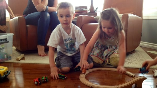 Easton Irwin loves to play trains with his twin sister Rowan.