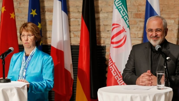 EU foreign policy chief Catherine Ashton, left, and Iranian Foreign Minister Mohammad Javad Zarif, right, said the world powers have agreed to a four-month extension of nuclear talks with Tehran after failing to meet a July 20 deadline.