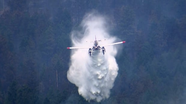 A firefighting aircraft attacks the Smith Creek fire in West Kelowna. Firefighters managed to partially contain the wildfire Friday, but warn they could quickly lose ground if winds pick up.