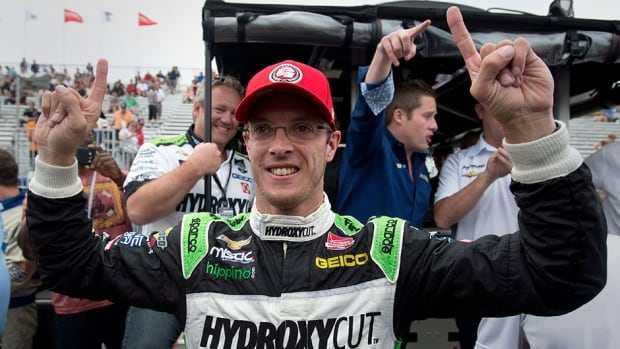 France's Sebastien Bourdais celebrates after winning the pole position for the first race of a weekend doubleheader at the Toronto Indy on Saturday.