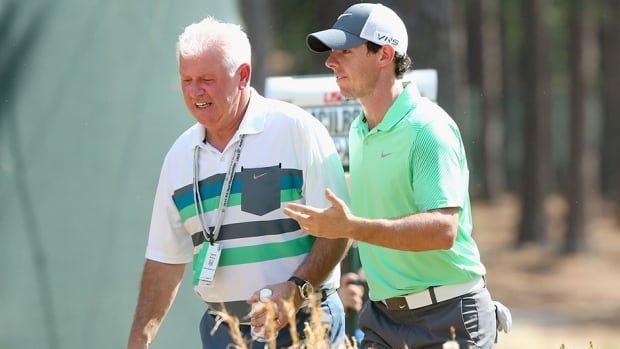 Rory McIlroy, right, is hoping he can earn some extra money for his father, left, with a British Open win on Sunday.