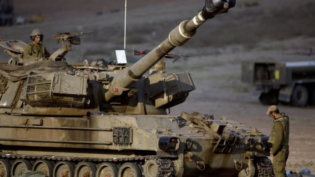 An Israeli artillery crew near the Israel and Gaza border prepares to fire toward Gaza. A senior Israeli defence official told reporters in Ottawa on Wednesday the Hamas tunnel network was surprising in its extent and sophistication.