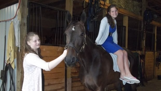 Nicole Reeves (right) and her sister Gillian won a rising star award Saturday from the Prince County Horsemen's Club.
