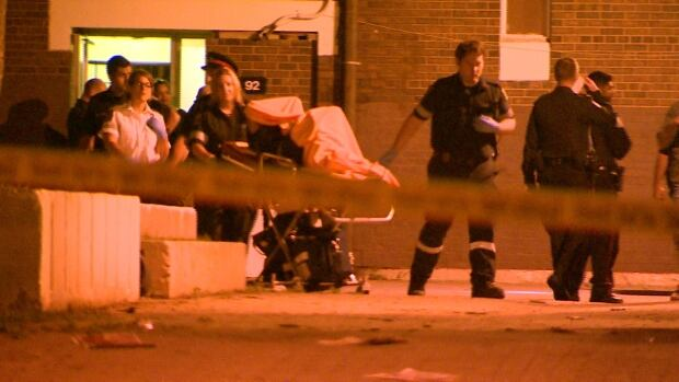Paramedics take a man to hospital after a shooting on Jamestown Crescent, near Finch Avenue and Martin Grove Road.