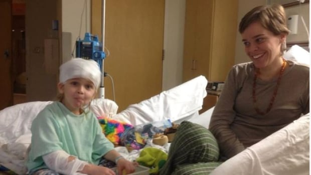 Lacey Spears, right, is charged with murder in the death of her son, Garnett-Paul, seen here in hospital days before he died. Prosecutors allege she poisoned him to death with salt, in a case that has the trappings of a rare psychiatric disorder called Munchausen by proxy.