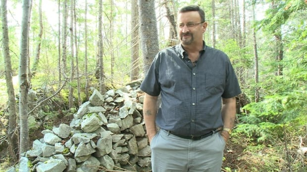 Frank Bartlett hopes a rock wall built by German prisoners of wall will be recognized as a unique piece of history.