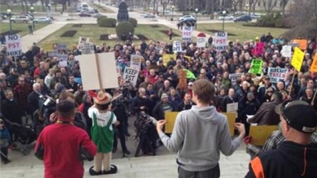 Hundreds of people protested at the Manitoba Legislature in June 2013 after the NDP government raised the provincial sales tax from 7 to 8 per cent and suspended an earlier requirement to hold a referendum.