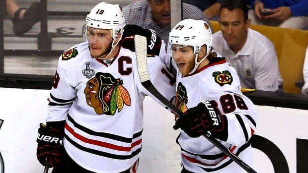 Jonathan Toews, left, and Patrick Kane will be Chicago Blackhawks teammates for almost the next decade.