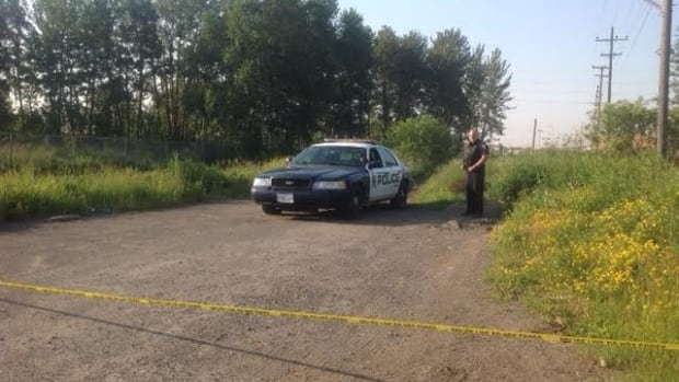 A Thunder Bay police officer guards the perimeter of the site near Field Street on Monday morning.