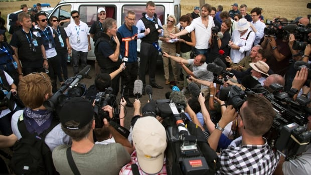 While forensic experts and members of the OSCE mission speak to the media in eastern Ukraine, in Moscow the Kremlin media strategy is to sow confusion, Russia experts say.