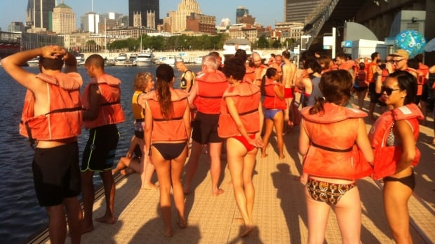 A group of Montrealers donned orange life vests before jumping into the St. Lawrence.