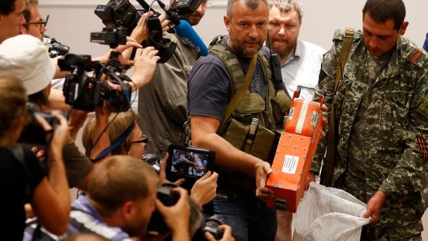 The two black boxes from Malaysian Airlines Flight MH17, which are actually orange in colour, were handed over to Malaysian authorities by pro-Russian separatists on Monday.