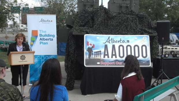 "Culture Minister Heather Klimchuk revealed the design of the new ""Support Our Troops"" licence plate in Edmonton on Tuesday."