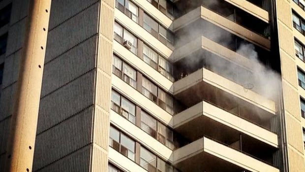Smoke can be seen from the balcony of a 16th floor apartment. No one was injured in the fire.