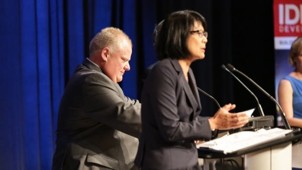 Mayor Rob Ford listens to fellow mayoral contender Olivia Chow during an election debate hosted in Scarborough by the Canadian Tamil Congress on July 15, 2014.