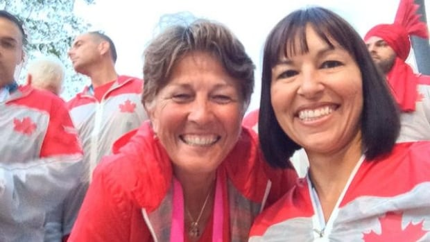 Canada's Commonwealth Games flag bearer Susan Nattrass, left, and chef de mission Chantal Petitclerc pose for a photo prior to entering the opening ceremony in Glasgow, Scotland.