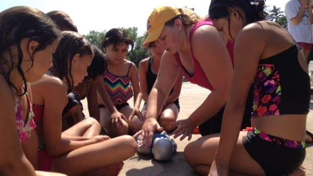 Youngsters at the Kinsmen Water Park in Prince Albert watch intently during a life saving demonstration, part of National Drowning Prevention Week.