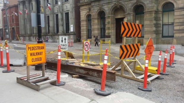 The Prince William Street restoration project has closed the street to vehicles and only one sidewalk is open for pedestrians. Some businesses say the construction and a slow tourist season has been financially tough on them.