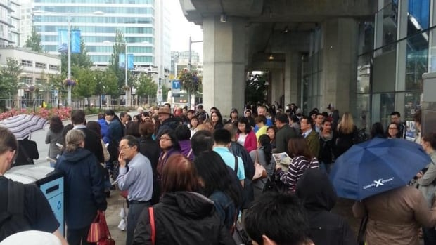 Passengers wait outside the Brighouse Canada Line station on Thursday morning.
