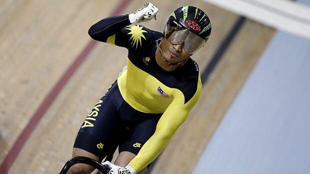 Azizulhasni Awang celebrates winning his heat in the men's sprint at Sir Chris Hoy Velodrome in Glasgow.