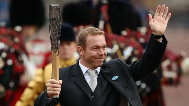 Sir Chris Hoy carries the Queen's Baton at Buckingham Palace last year.