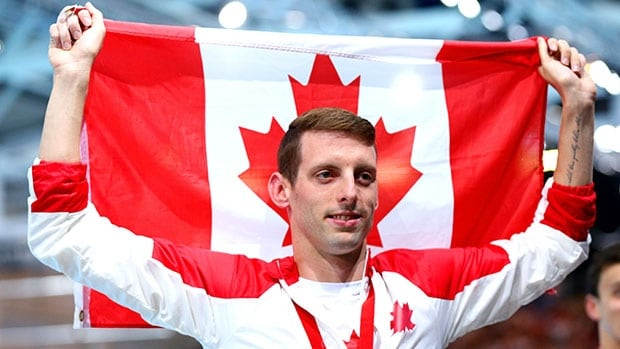 Swimmer Ryan Cochrane won Canada's first gold medal of the Games when he repeated as champion in the men's 400m freestyle.