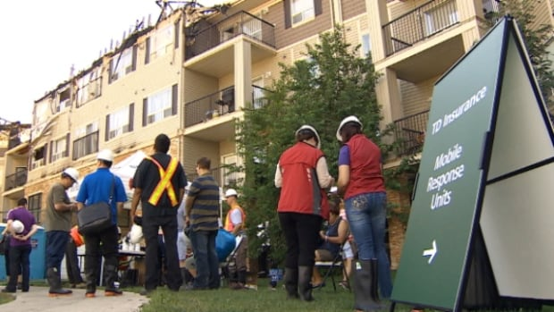 Three days after a $10 million fire devastated their homes, some condo residents were allowed to return to their suites to see if they could recover anything.