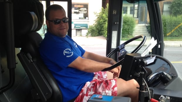 This STM bus driver donned a pair of Hawaiian beach shorts to protest against the Quebec government's pension bill.