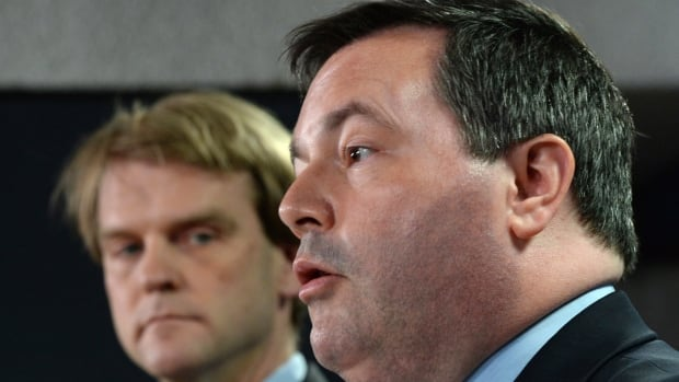 Employment Minister Jason Kenney, right, and Immigration Minister Chris Alexander are accused of violating the rights of a Labrador couple suspended from using the Temporary Foreign Worker Program, say documents sent to CBC News by the couple's lawyer.