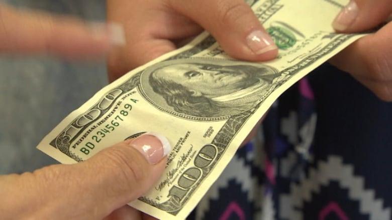 Windsor police arrest several men spending counterfeit money