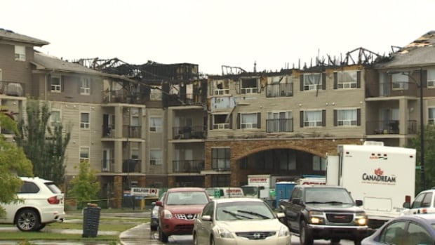 Some of the 400 people displaced after a condo fire were allowed to return to their suites to see if they could recover anything on Thursday. One resident told CBC News she noticed an iPad and iPhone were missing.