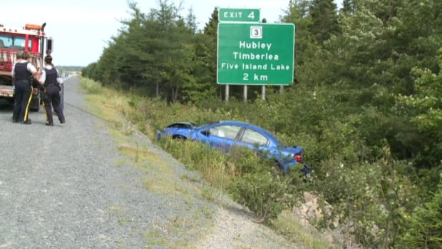 RCMP at the scene of a crash on Highway 103 July 27.