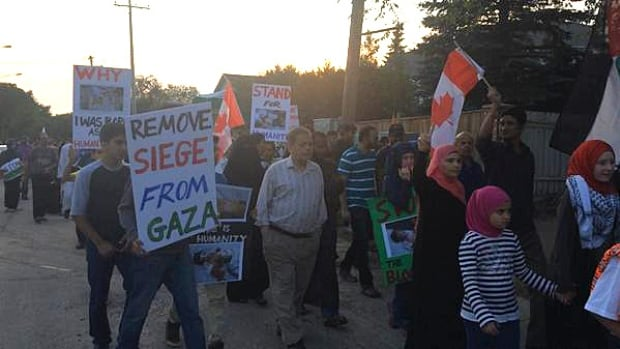 Roughly 300 pro-Palestinian people marched down 8th Street in Saskatoon Saturday night.