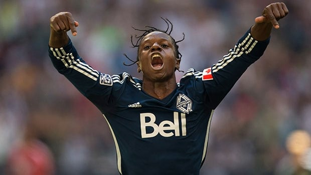 Vancouver Whitecaps forward Darren Mattocks celebrates after scoring against FC Dallas on Sunday at BC Place.