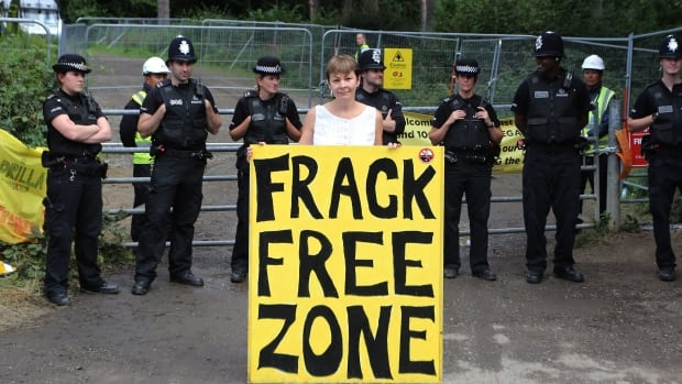 Former Green Party leader Caroline Lucas stands outside the Cuadrilla exploratory drilling site in Balcombe, U.K., amid anti-fracking demonstrations near the drill site in August 2013. Britain has begun to accept bids for licences to explore for shale gas in more than half the country, despite controversy surrounding the hydraulic fracturing technique.