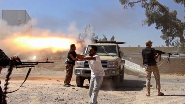 Fighters from the Islamist Misarata brigade fire towards Tripoli airport in Libya in an attempt to wrest control from a powerful rival militia, in a frame grab from video taken July 26, obtained from a freelance journalist travelling with the Misarata brigade. On Saturday, the U.S. moved its diplomats from Tripoli to neighbouring Tunisia and shut its embassy.