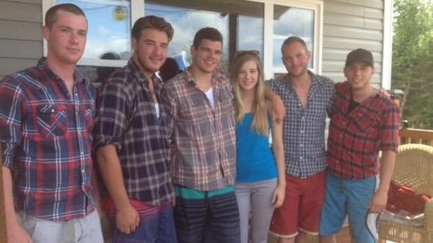 A group of Canadian military and ex-military personnel rescued a woman from a burning vehicle on the highway in central Newfoundland on Sunday. From left, Nick Bronson, Adrien Guindon, Ryan Elliott, Danielle Elliott, Ryan Folkes, Lee Westenlaken.