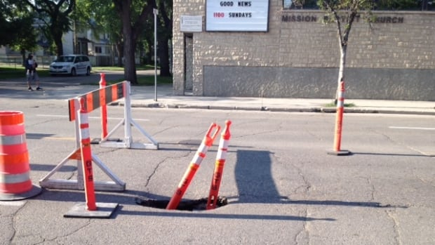 This sinkhole was cordoned off on Sargent Avenue near Home Street as of late Monday afternoon.