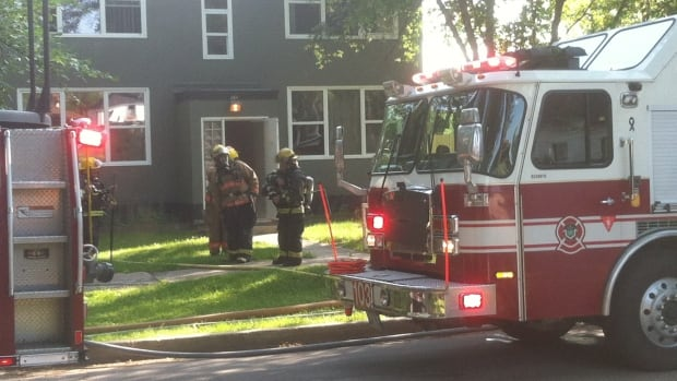 Winnipeg firefighters deal with a fire inside an apartment building in the 300 block of Stella Avenue late Monday afternoon.
