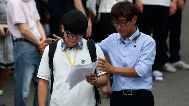 A representative of students who survived South Korea's April 16 ferry disaster cries during his return to class last month. Most of the students believe the ferry's crew must be penalized in line with the law.