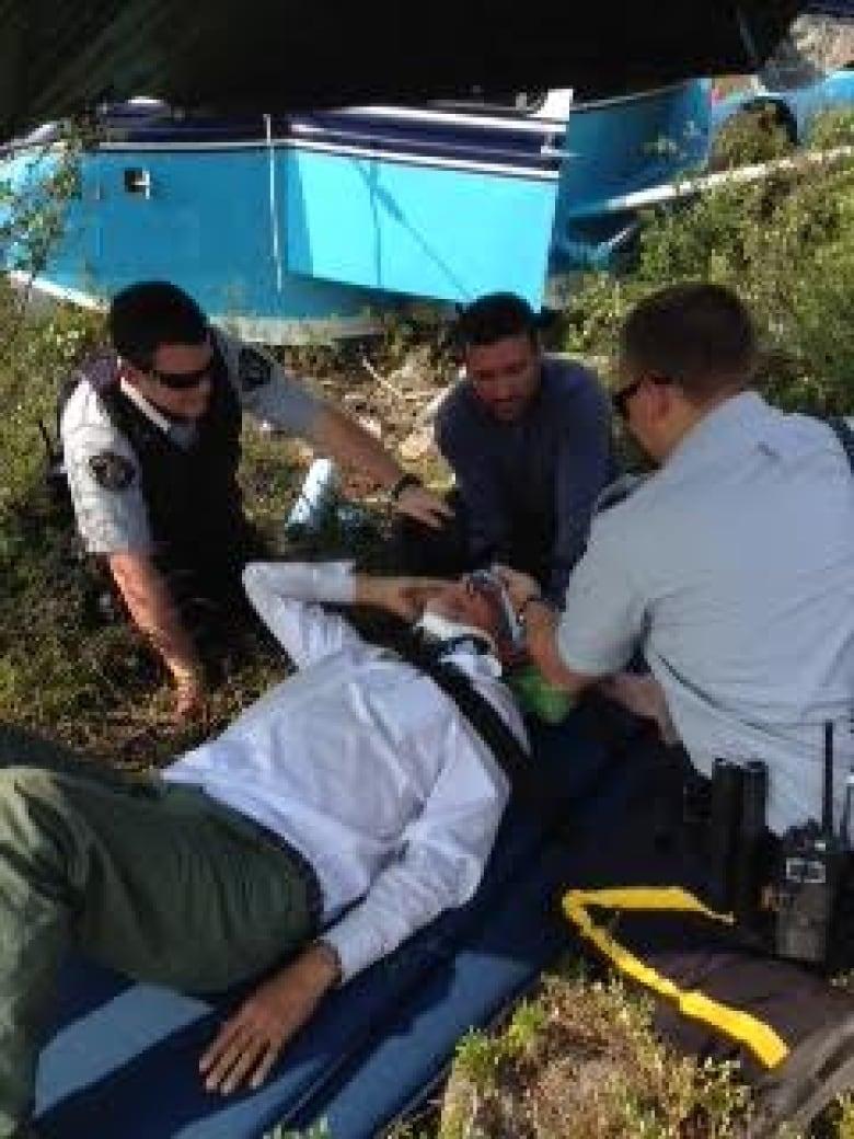 Pilot Henry Chapeskie Gets Medical Attention At Scene
