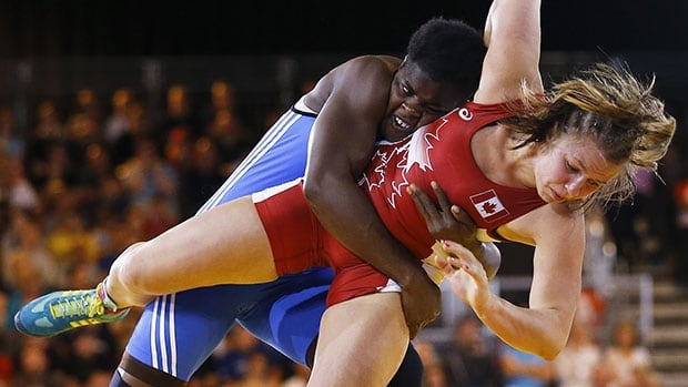 Canadian wrestler Erica Wiebe, right, defeated Nigeria's Blessing Onyebuchi in the semifinals, then went on to win gold in the women's 75-kg division.