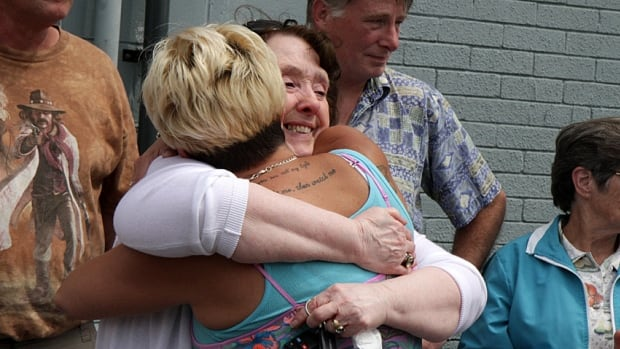 Gail Sullivan, Michael Sullivan's mother, hugs a supporter after making another plea for anyone who can help find the person responsible for her son's death.