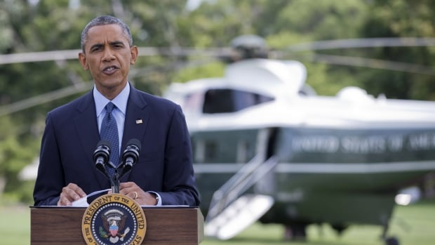 President Barack Obama speaks on the South Lawn of the White House in Washington, on Tuesday as he announced new economic sanctions against key sectors of the Russian economy in the latest move to force Russian President Vladimir Putin to end his support for Ukrainian rebels.