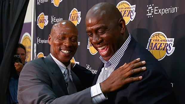 Byron Scott, left, and Earvin (Magic) Johnson enjoy a hearty chuckle at Toyota Sports Center in El Segundo, Calif, on Tuesday.