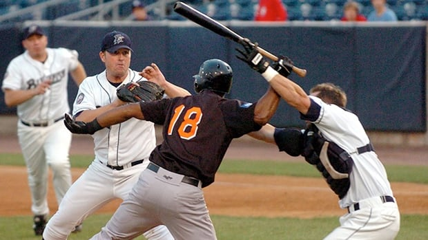 John Nathans, right, tries to prevent Jose Offerman (18) from hitting pitcher Matt Beech in Bridgeport, Conn., on Aug. 14, 2007.