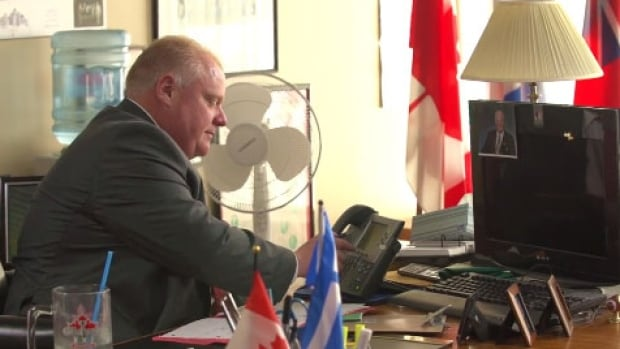 The campaign video shows Mayor Rob Ford returning phone calls in what appears to be his city hall office. Rules prohibit use of the city resources in campaign materials.