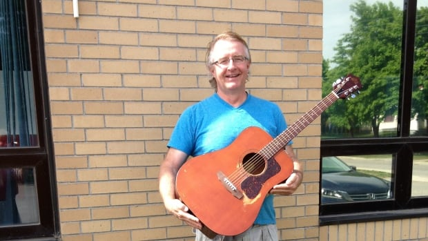 Sheldon McBrearity plays a 1974 Guild D25M guitar.