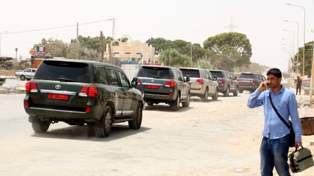 Diplomatic cars returning from Libya arrive at the border crossing of Ras el-Jedir Ben Guerdane, southeast of Tunis, capital of Tunisia.
